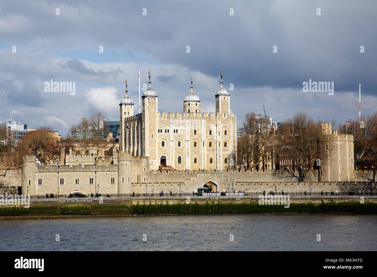 Tower of London and Traitors Gate on the banks of the Thames River. The gate was built by Edward I to provide a water gate entrance to the Tower. - Stock Image