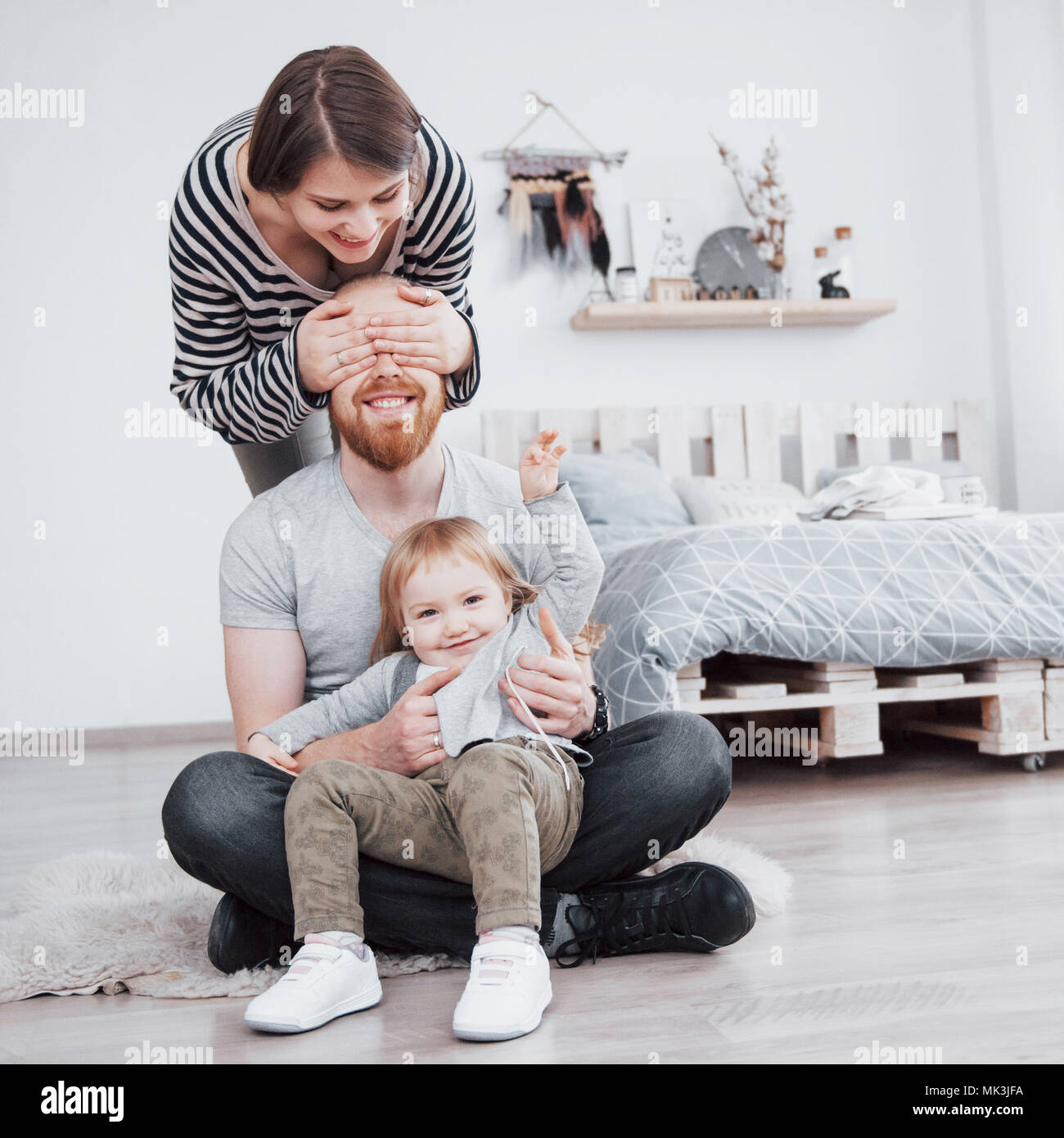 happy family mother, father, child daughter at home - Stock Image