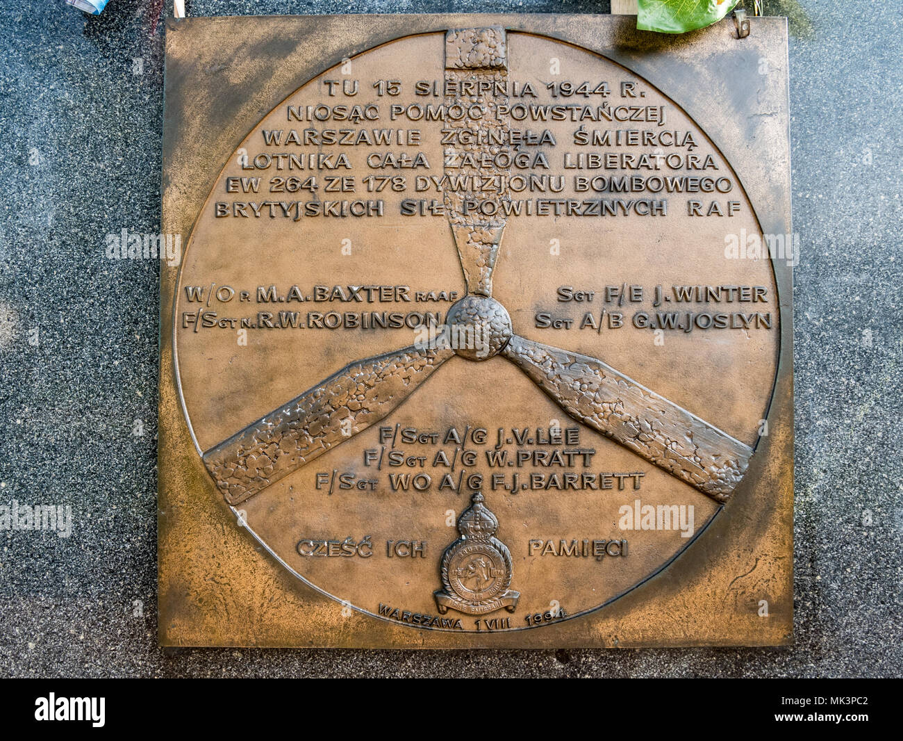 Memorial stone commemorating victims of Liberator crash during WW2, Warsaw, Poland - Stock Image