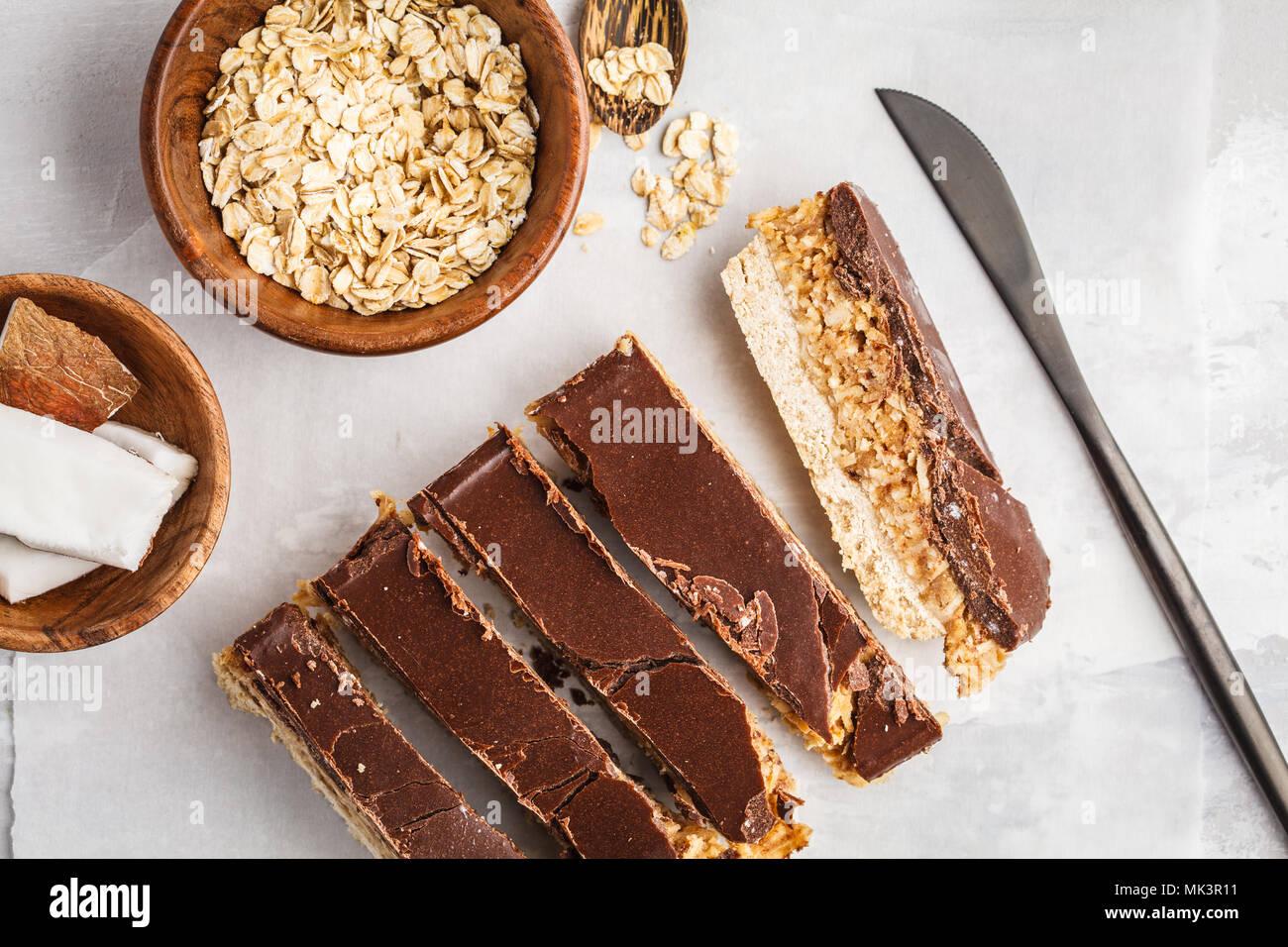 Coconut-oat raw vegan bars. Top view, copy space. Healthy vegan food concept. - Stock Image