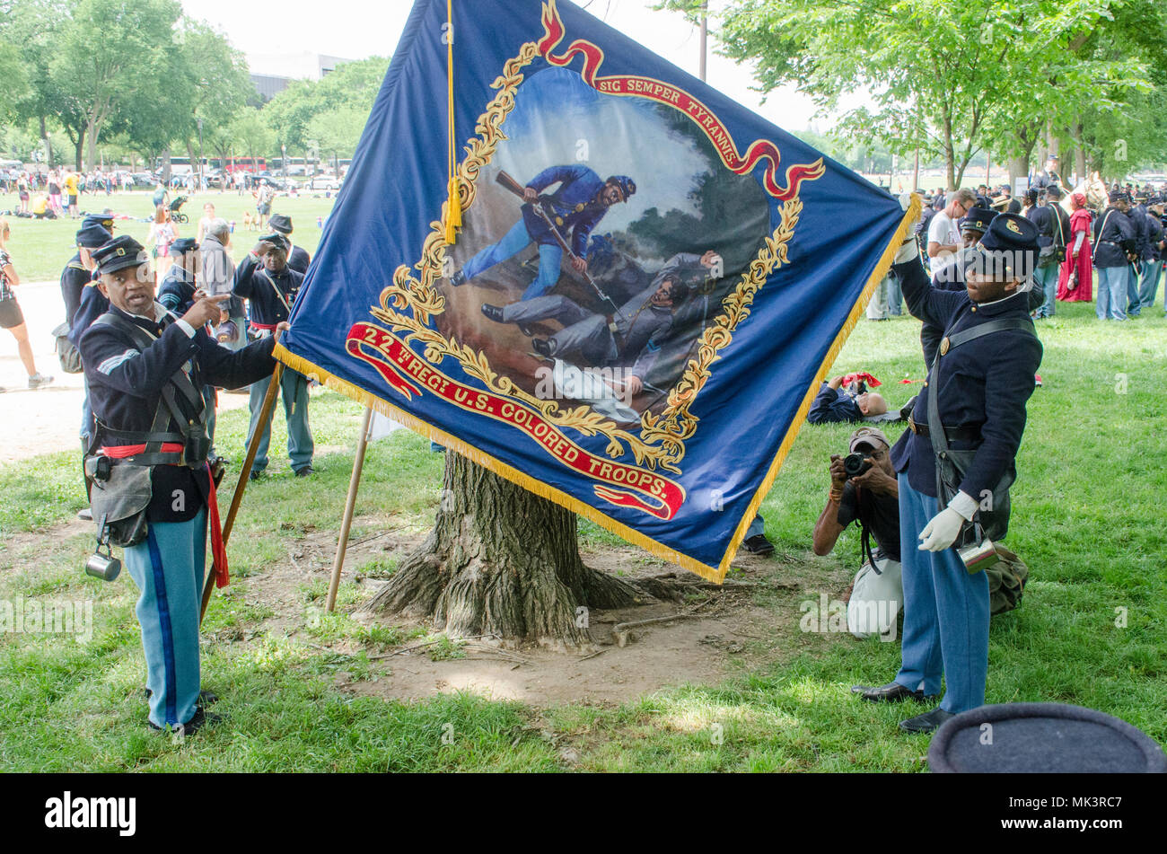 African American Civil War reenactors explain the regimental flag of ther 22n Regiment U.S. Colored Troop, in Washington DC. The gathering marked the  - Stock Image