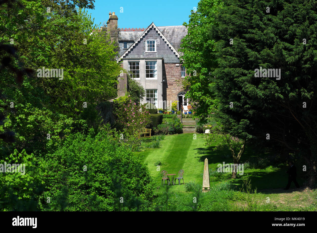 Hereford UK riverside house home and garden beside the River Wye in the city - Stock Image