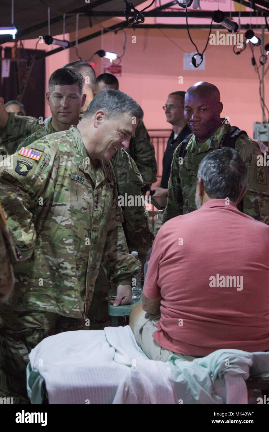 SAN JUAN, Puerto Rico -- Gen. Mark A. Milley, the Chief of Staff of the Army, speaks with a patient under the care of Army doctors and nurses attached to the 14th Combat Support Hospital in Humacao, Puerto Rico, 3 Nov. 2017. While at the site, Milley checked in on many patients and spoke with Col. Rachele Smith, 14th CSH commander, about her unit's mission to provide temporary medical, surgical, and acute care services to the Humacao area. Milley spent the day visiting troop sites around the island in order to personally assess the status, effectiveness, and morale of the thousands of military - Stock Image