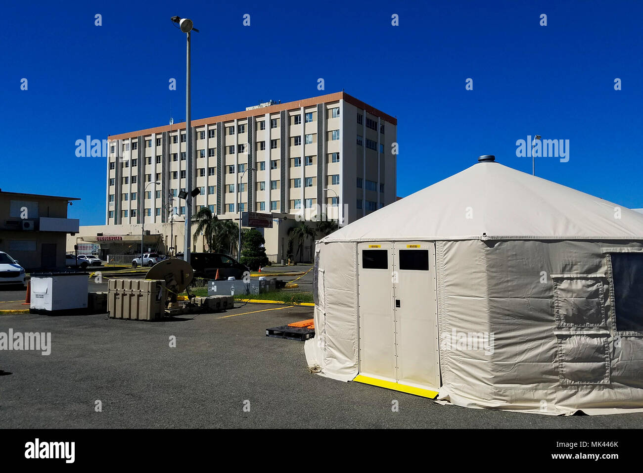 AGUADILLA, Puerto Rico – A tent from the department of Health and Human Services is set up in front of the Buen Samaritano Hospital Nov. 3, 2017. HHS, Air Force and Army medical providers have offered basic to acute care to residents throughout the region since Hurricane Maria rendered the hospital inoperable. (U.S. Army photo by Capt. J. Scott Detweiler) - Stock Image