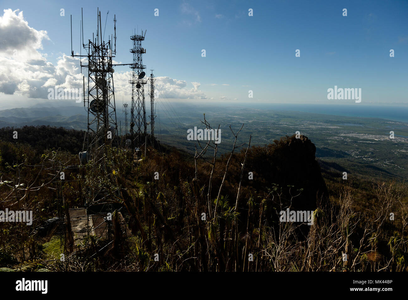 Airmen with the 85th Engineering Installation Squadron, Keesler Air Force Base, Miss., repair the cell towers on El Yunque Peak in El Yunque National Forest, Puerto Rico, Nov. 3, 2017 after Hurricane Maria devastated the tropical rainforest and damaged the communications towers. (U.S. Air Force photo by Master Sgt. Joshua L. DeMotts) Stock Photo