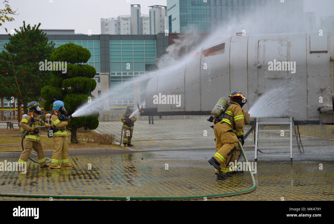 Us air force firefighters assigned to osan air base and local us air force firefighters assigned to osan air base and local korean firefighters work together to extinguish a simulated aircraft fire during a bilateral platinumwayz