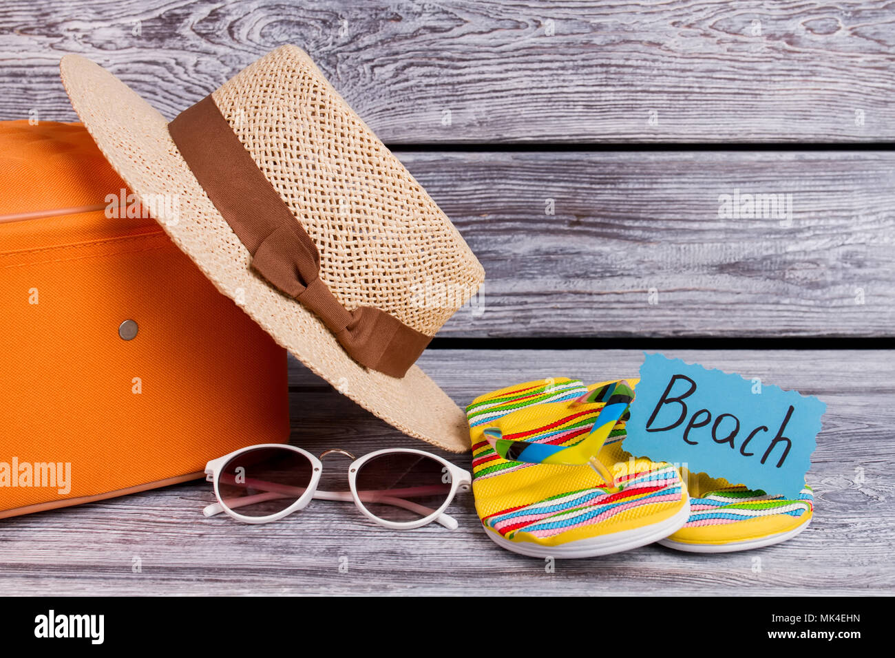 6058eef6e6 Beach clothing concept. Women's beachwear and accessories on wooden  background.