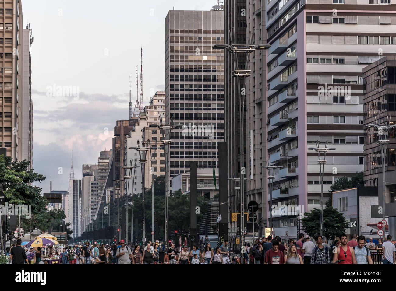 2018, May; Sao Paulo, Brazil. People and buildings on a Sunday at the famous Paulista Avenue. On sundays the avenue is closed for cars and opened for  - Stock Image