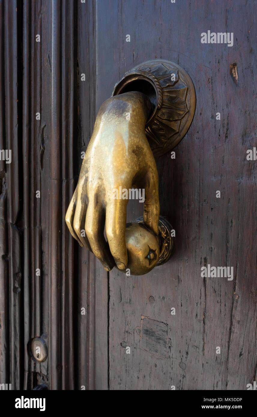 In San Miguel De Allende, An Ornate Brass Hand Door Knocker   Stock Image