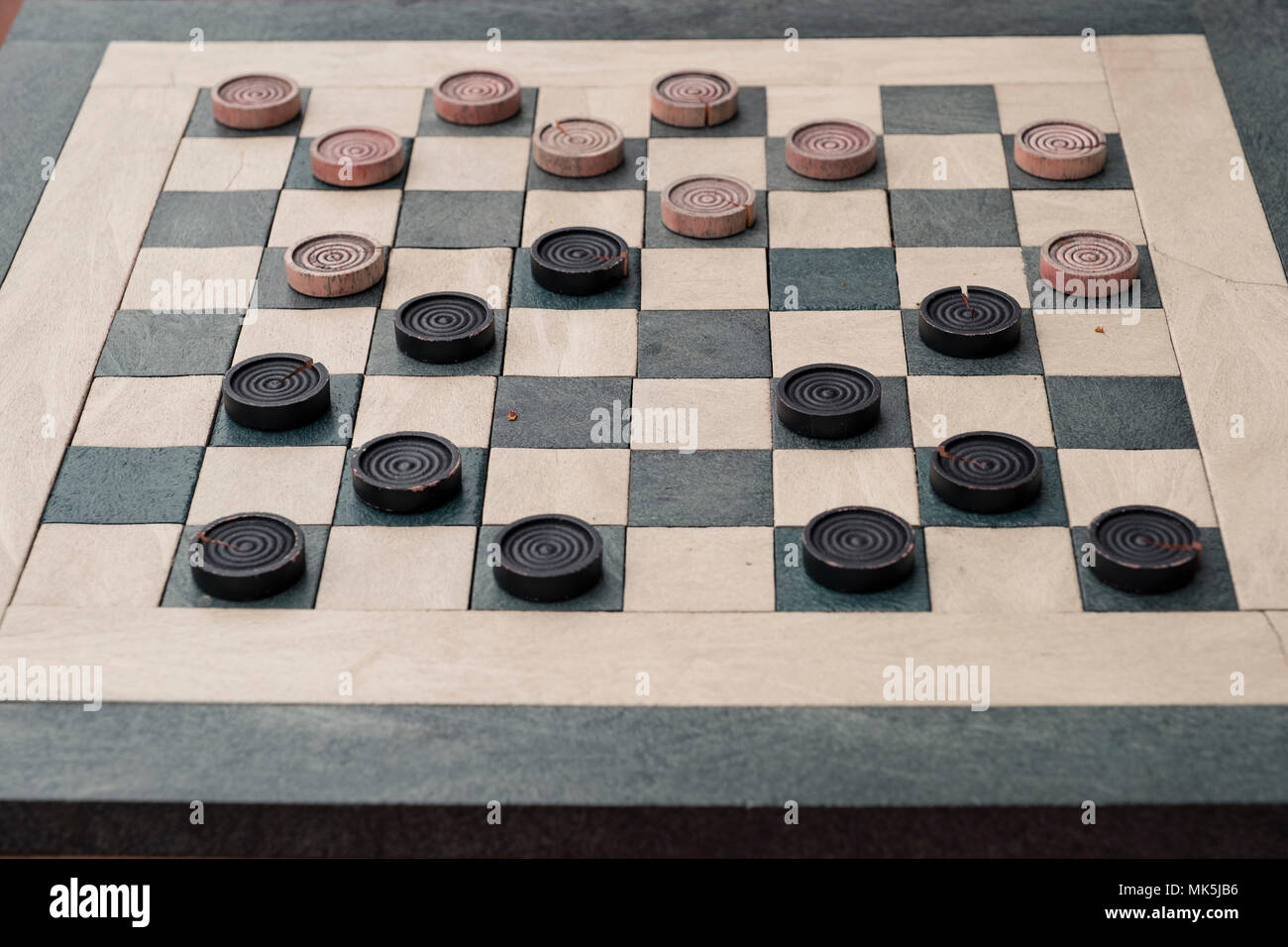 checkers game in public on sidewalk, step up and take a seat to play the game with a friend or stranger Stock Photo