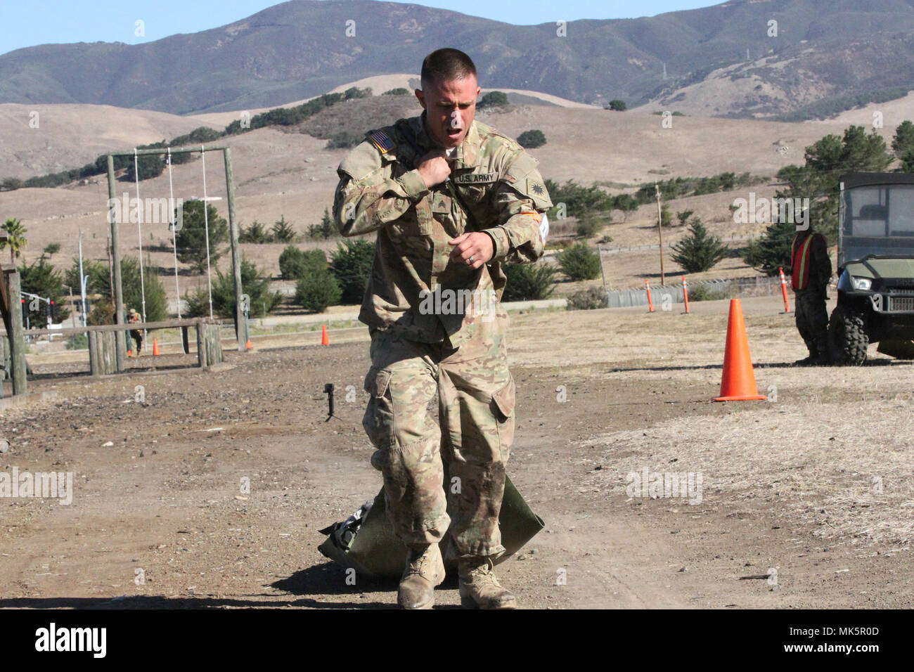 Sgt. Joshua Monday drags a 180-pound medical prop to the obstacle ...