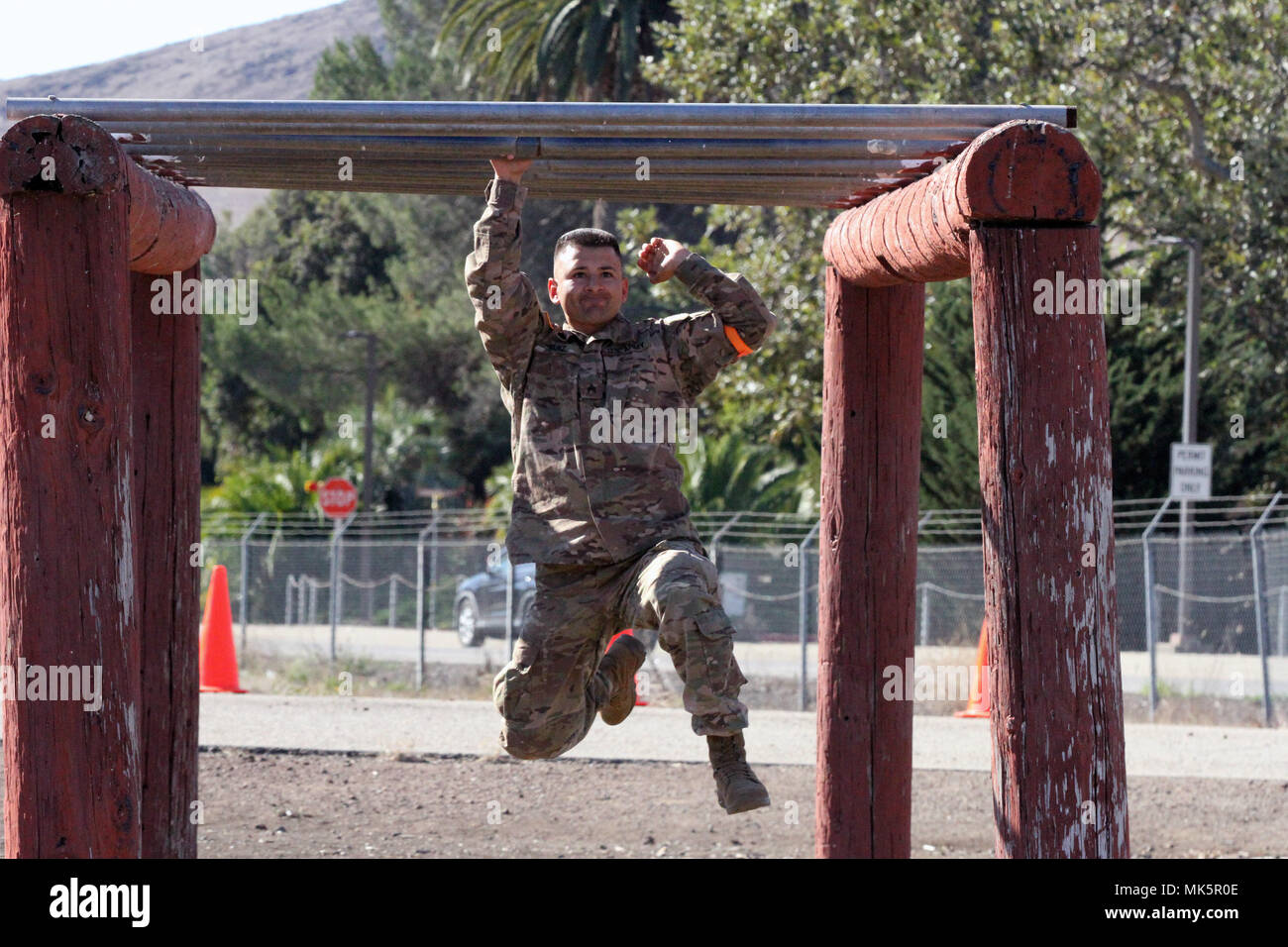 Sgt. George Ruiz works his way through the monkey bars in the ...
