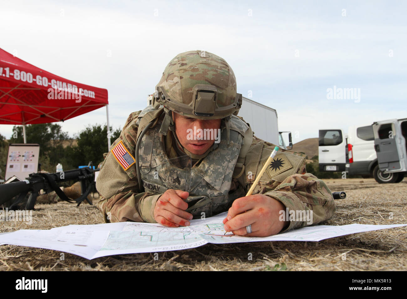 Sgt. Joshua Monday uses a protractor and map to plot five ...