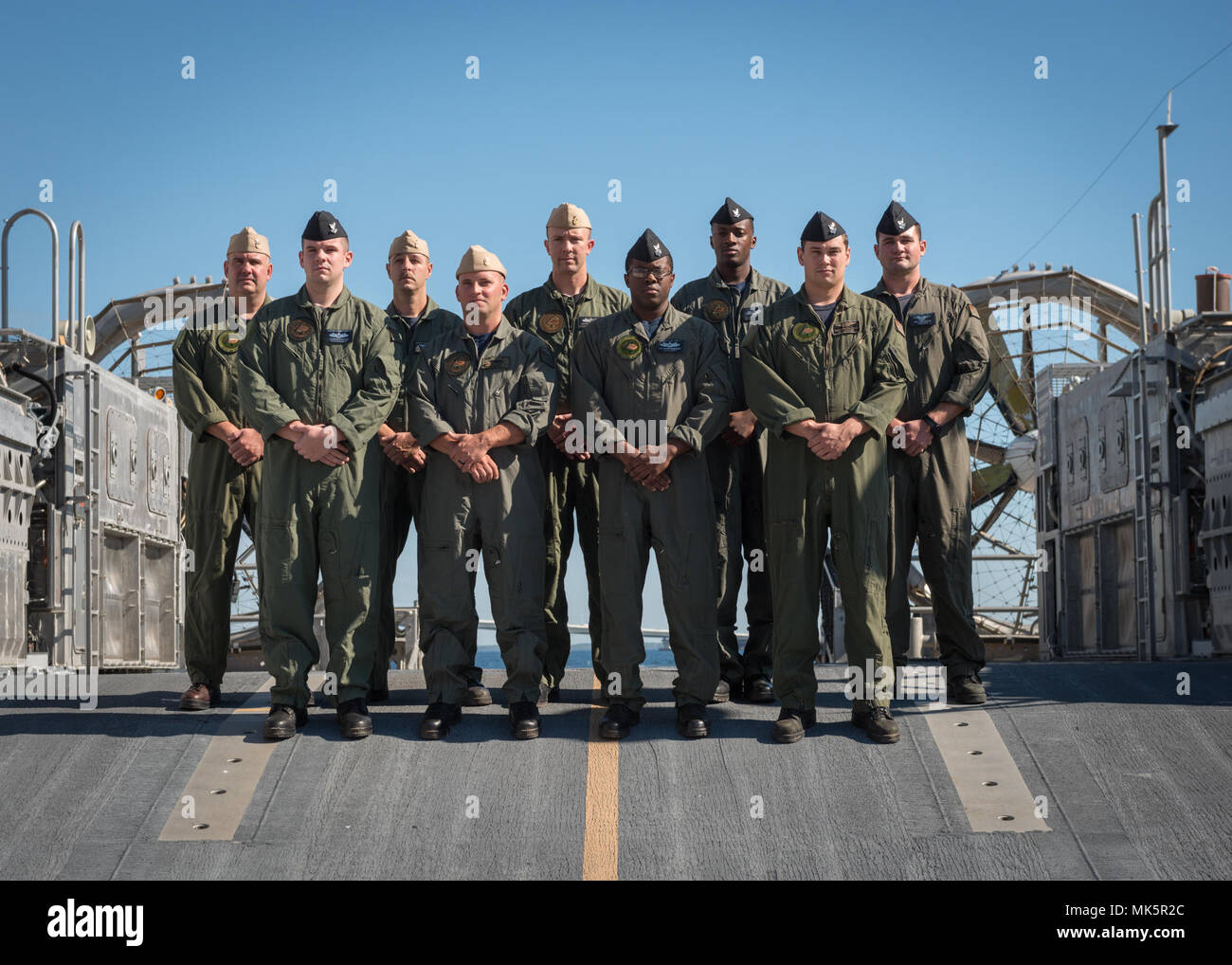 Sailors from Assault Craft Unit Four (ACU 4), based in Little Creek, Virginia show presence of their being detached to the Naval Surface Warfare Center Panama City Division (NSWC PCD) by standing on deck aboard NSWC PCD's Landing Craft Air Cushion (LCAC) 91. U.S. Navy Photo by Anthony Powers. - Stock Image