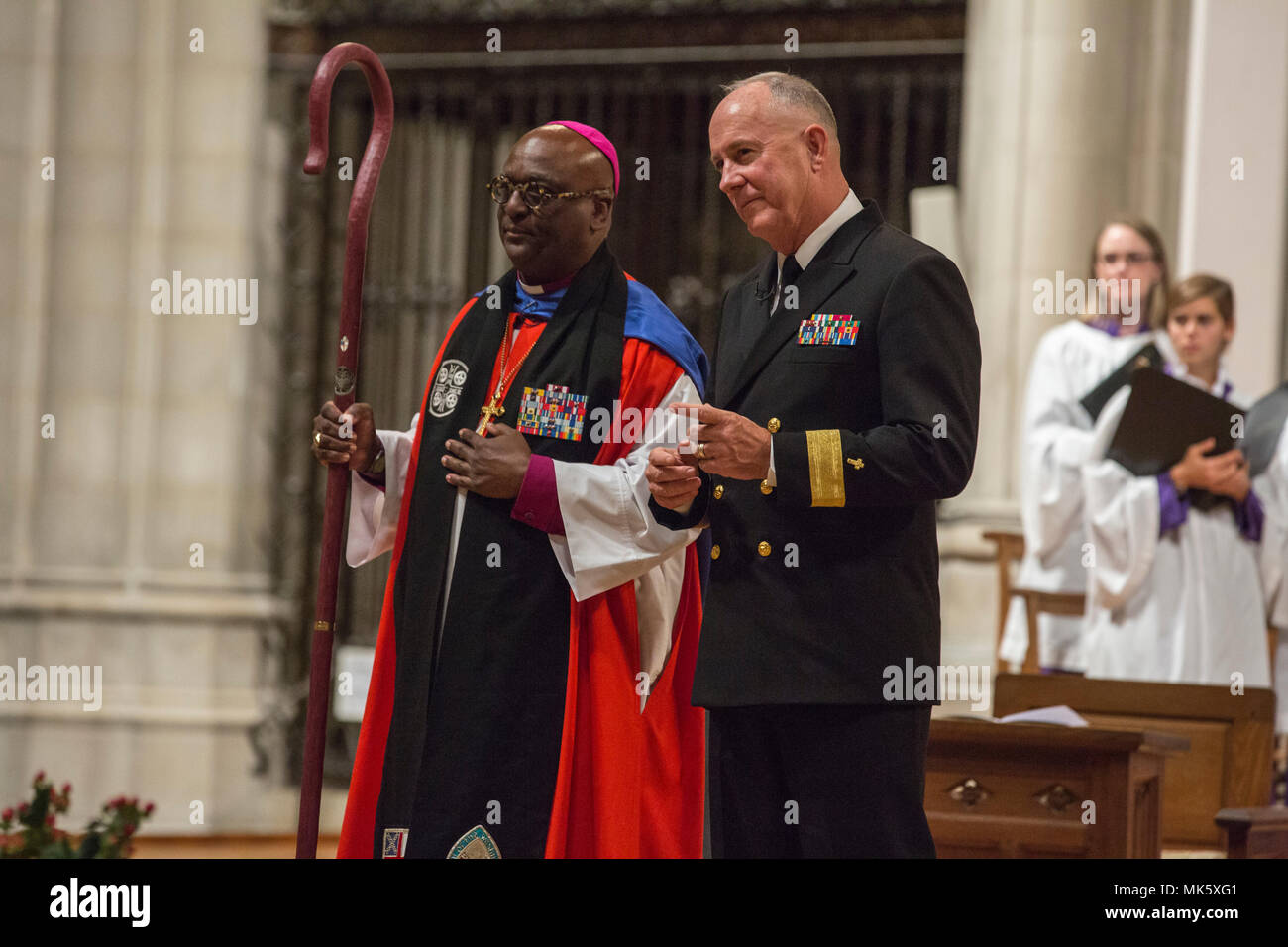 From left, The Right Reverend Carl W. Wright, bishop suffragan for Armed Service and Federal Ministries and U.S. Navy Rear. Adm. Brent W. Scott, 19th chaplain of the Marine Corps, gives remarks during the Marine Corps Worship Service at the Washington National Cathedral, Washington, D.C., Nov. 12, 2017. The worship service honored the Marines Corps' 242nd anniversary. (U.S. Marine Corps photo by Lance Cpl. Alex A. Quiles) - Stock Image
