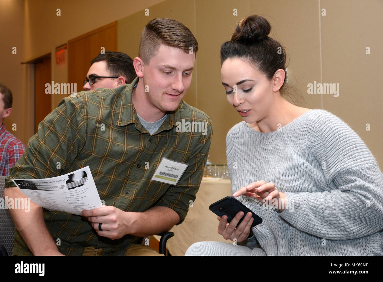 Staff Sgt Nicholas Osowick An Airmanigned To The 105th Airlift Wing Discusses Results With His Partner Of A 5 Love Languages Exercise During A Yellow