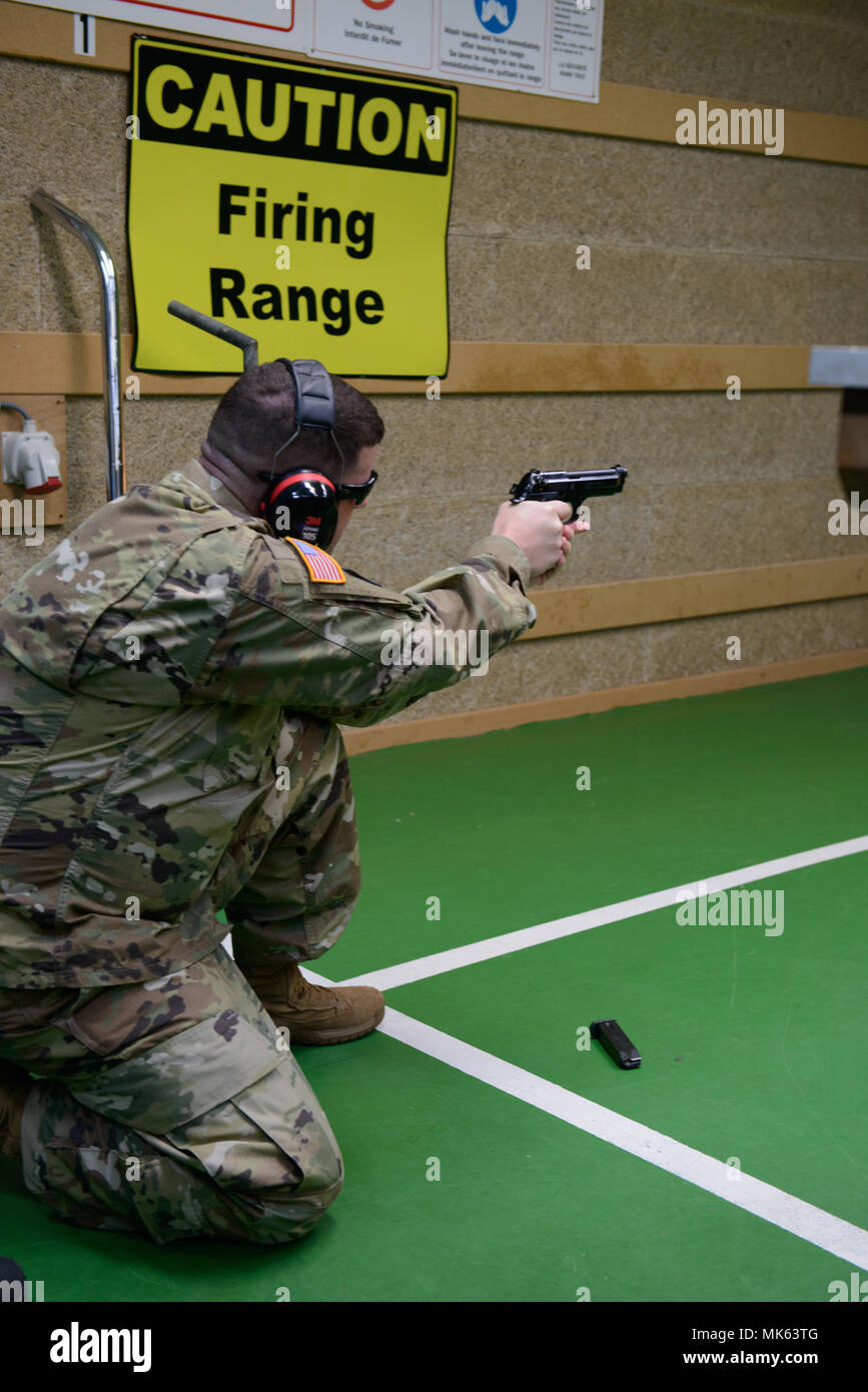 d52d2a97272 A U.S. Soldier with the 650th Military Intelligence Group fires an M9  pistol in the kneeling