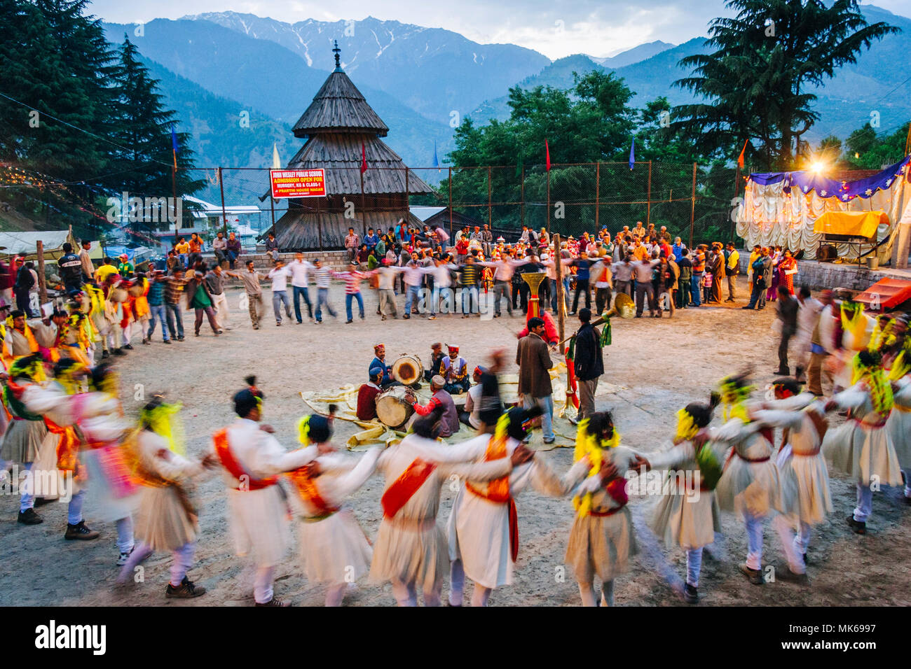 Nagar, Himachal Pradesh, India : During the Naggar Mela festival high caste rajputs dance in circles in honor of the local deity Tripura Sundari outsi - Stock Image
