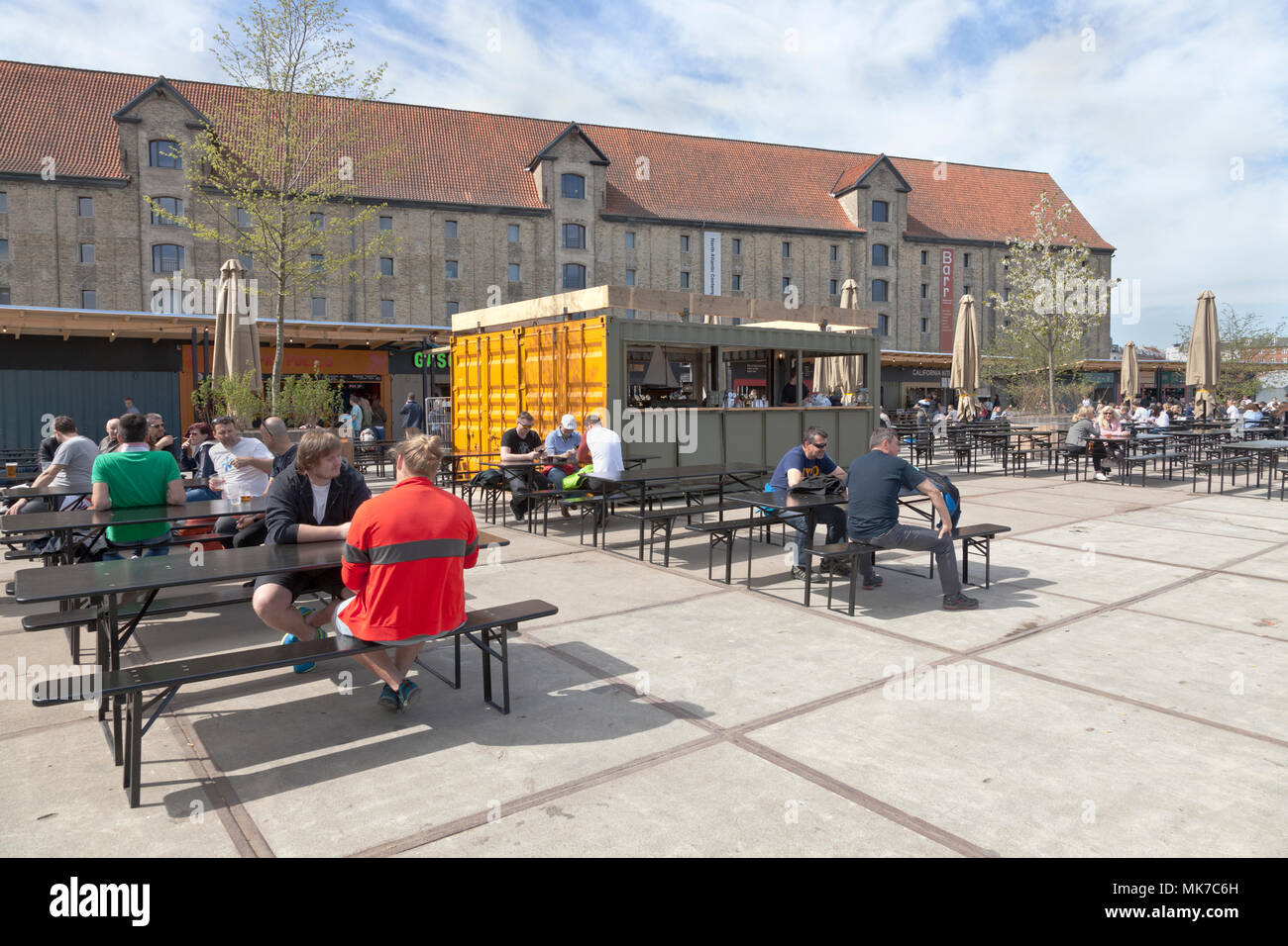 The opening day of new street food market in Copenhagen at the Greenlandic Trading Square in Christianshavn, where the Inner Harbour Bridge is landing - Stock Image