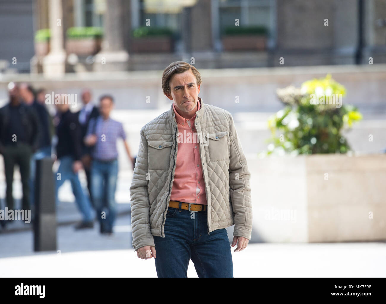 Actor, writer and comedian, Steve Coogan, playing the part of Alan Partridge outside the BBC Studios in central London - Stock Image