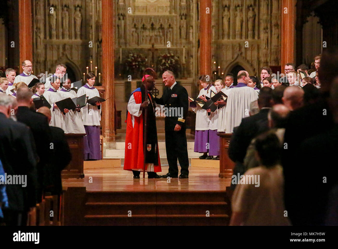The 19th Chaplain of the Marine Corps, Rear Adm. Brent W. Scott, and the Bishop Suffragan for Armed Services and Federal Ministries, the Right Reverend Carl W. Wright, prepare to walk down center aisle at the conclusion of a Marine Corps Worship Service at the Washington National Cathedral, Washington D.C., Nov. 12, 2017. The service was held to commemorate the 242nd Anniversary of the Marine Corps. The 19th Chaplain of the Marine Corps, Rear Adm. Brent W. Scott, addressed his message to the guests in attendance. (Official U.S. Marine Corps photo by Cpl. Robert Knapp/Released) - Stock Image