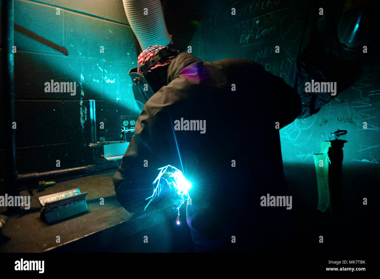 A student from Africa practices welding as part of the Lake Chad Basin Initiative, Nov. 15, 2017 at the Naval Small Craft Instruction and Technical Training School on Stennis Space Center, Miss. NAVSCIATTS is working through the Trans-Sahara Counterterrorism Partnership to facilitate the inaugural iteration of the Lake Chad Basin Initiative. The objective of the iteration is to increase partner nations' abilities to project force against violent extremist organization safe havens within the Lake Chad region using continental United States based maintenance and leadership training prior to the  - Stock Image