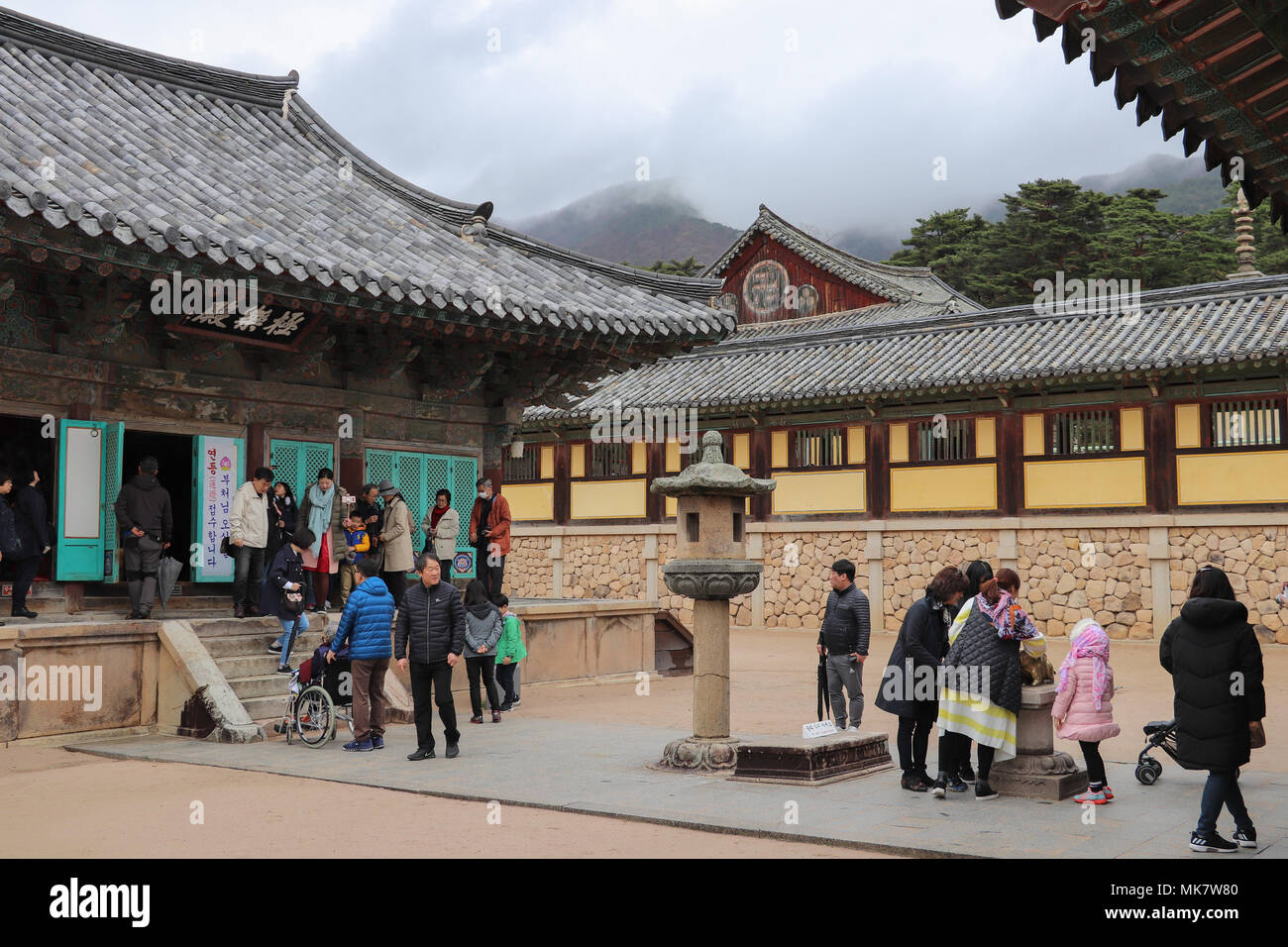 Families enjoy visiting the historic Bulguksa Temple complex in South Korea, a UNESCO site with Silla architecture, original stonework, in mountains. Stock Photo