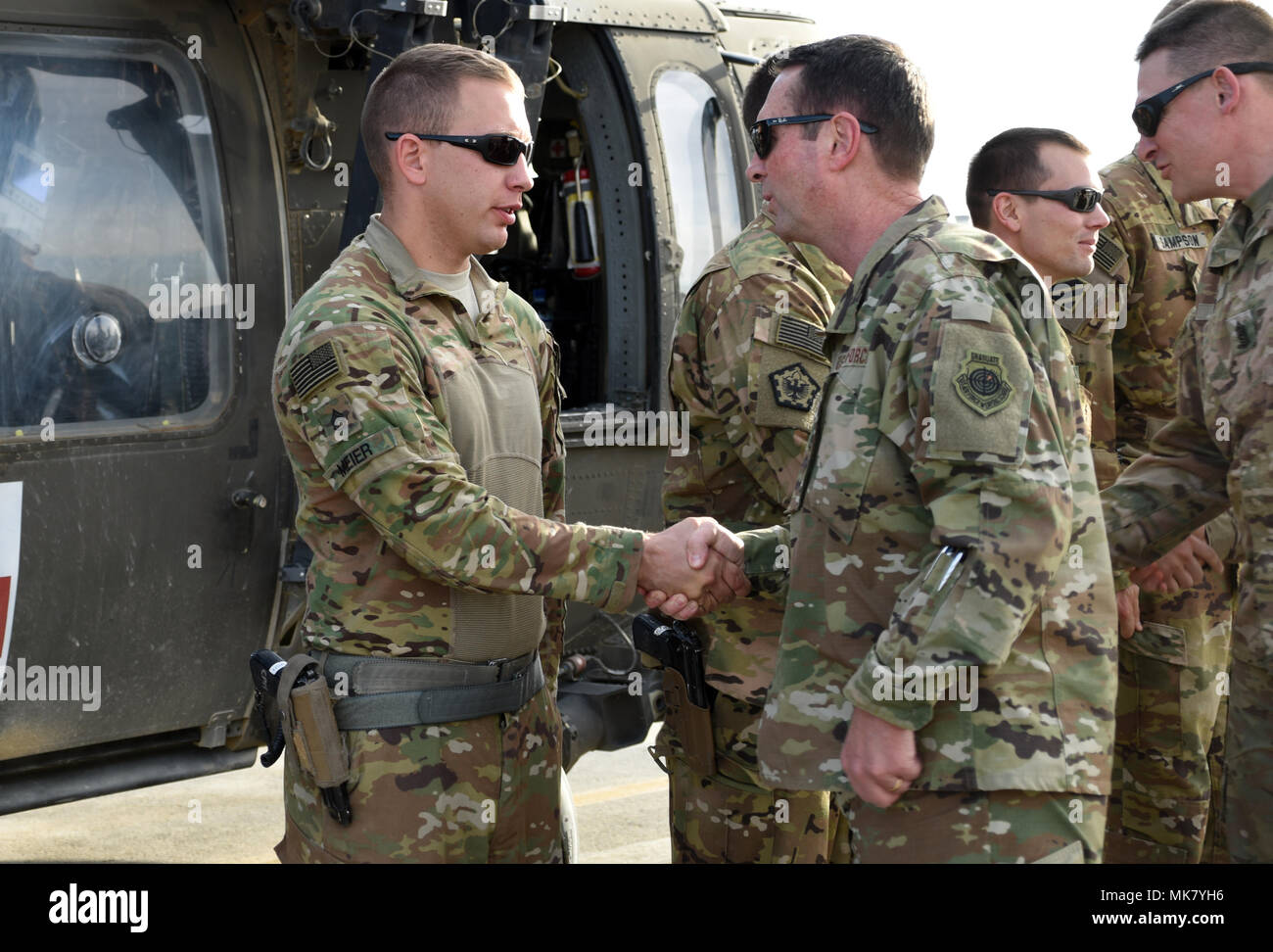 U.S. Army Soldiers with Task Force Marauder were presented with coins from U.S. Air Force Gen. Joseph Lengyel, Chief, National Guard Bureau, Nov. 23, 2017 in Afghanistan for their recent actions in response to a mass casualty involving U.S. Soldiers. Lengyel recognized Soldiers with Detachment 1, C Company, Medical Evacuation, 2-211th General Support Aviation Battalion (GSAB) with the Iowa National Guard and C Company, 4-3 Assault Helicopter Battalion (AHB), 3rd Combat Aviation Brigade, who responded to a vehicle borne improvised explosive device strike against an American convoy Nov. 13, 2017 Stock Photo