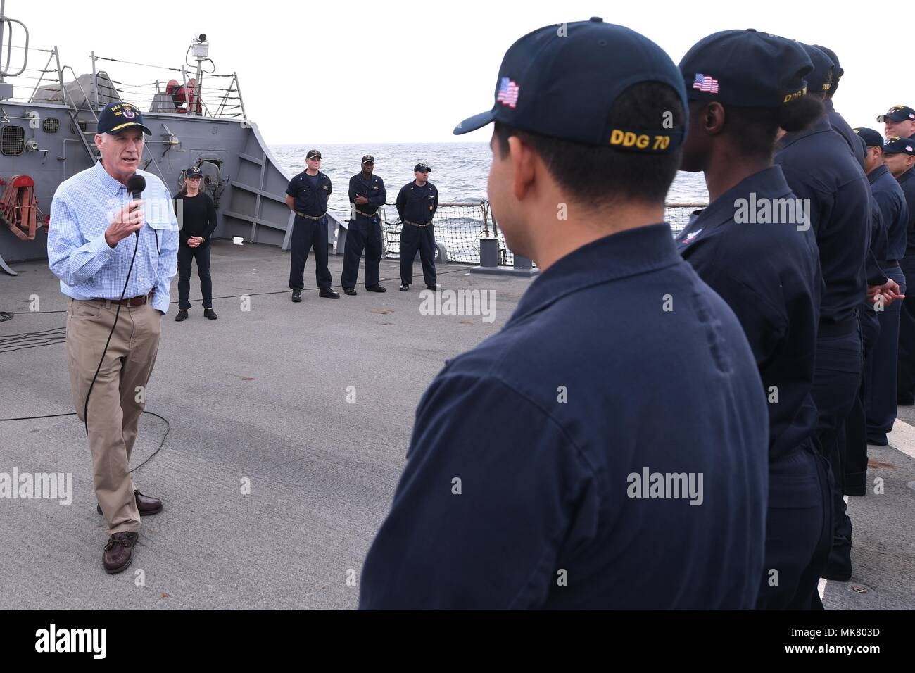 ARABIAN GULF (Nov. 23, 2017) Secretary of the Navy Richard V. Spencer addresses crewmembers of the Arleigh Burke-class guided-missile destroyer USS Hopper (DDG 70) during an all-hands call on the ship's flight deck on Thanksgiving Day. Hopper is deployed to the U.S. 5th Fleet area of operations in support of maritime security operations to reassure allies and partners and preserve the freedom of navigation and the free flow of commerce in the region. (U.S. Navy photo by Mass Communication Specialist 2nd Class Kristina Young/Released) - Stock Image