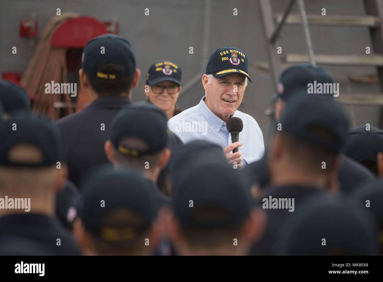 ARABIAN GULF (Nov. 23, 2017) Secretary of the Navy Richard V. Spencer addresses crewmembers of the Arleigh Burke-class guided-missile destroyer USS Hopper (DDG 70) during an all-hands call on the ship's flight deck on Thanksgiving Day. Hopper is deployed to the U.S. 5th Fleet area of operations in support of maritime security operations to reassure allies and partners and preserve the freedom of navigation and the free flow of commerce in the region. (U.S. Navy photo by Fire Controlman 1st Class Joseph Saxon/Released) - Stock Image