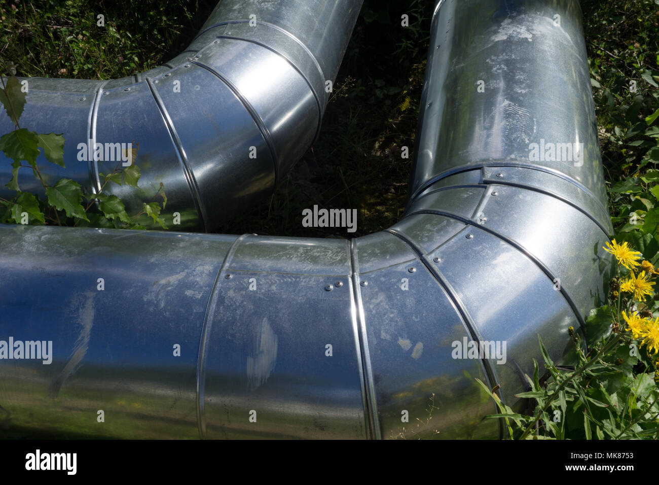 galvanized sheet metal pipe for drainage Zinc drain pipe - Stock Image