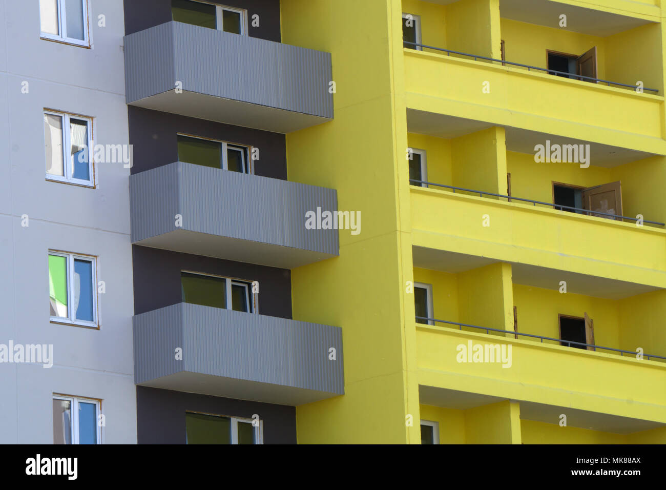 yellow colorful house walls and Windows with open decorated with ...