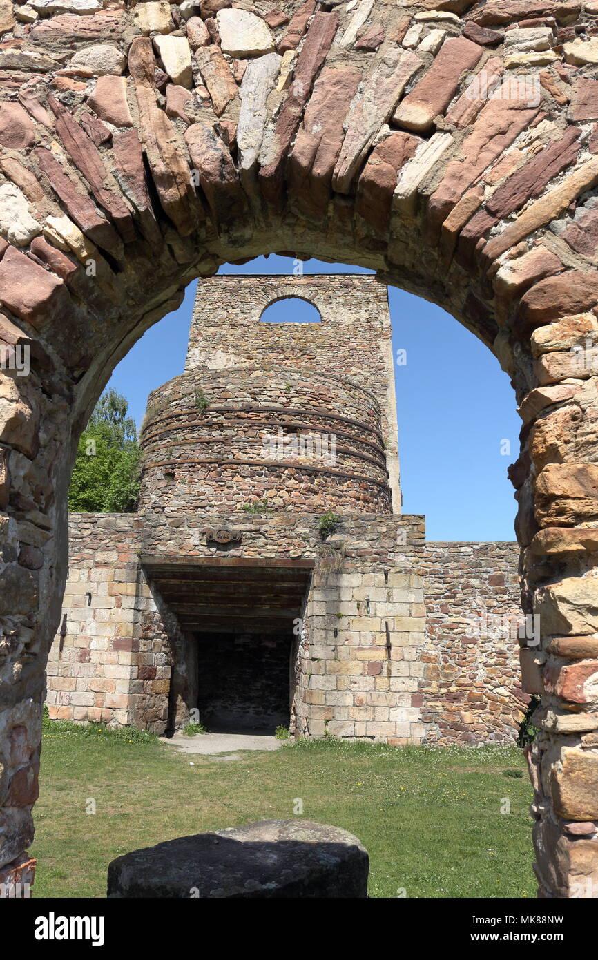 Blast furnace - main part of ruins of 19th century ironworks in Samsonow, Poland - Stock Image