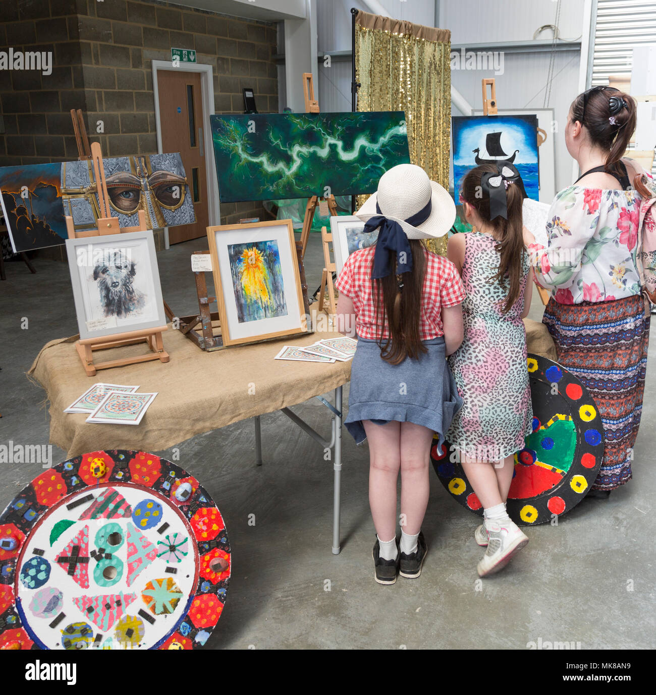 Art display stall at Sprit of Beowulf event,  Woodbridge, Suffolk, England, UK - 5th May 2018 - Stock Image