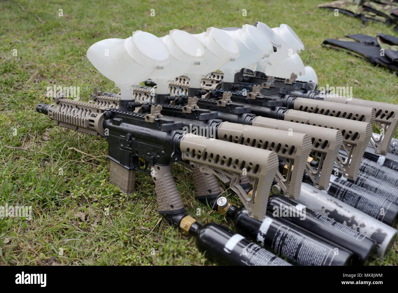 Paintball guns on Battlefield ground Stock Photo