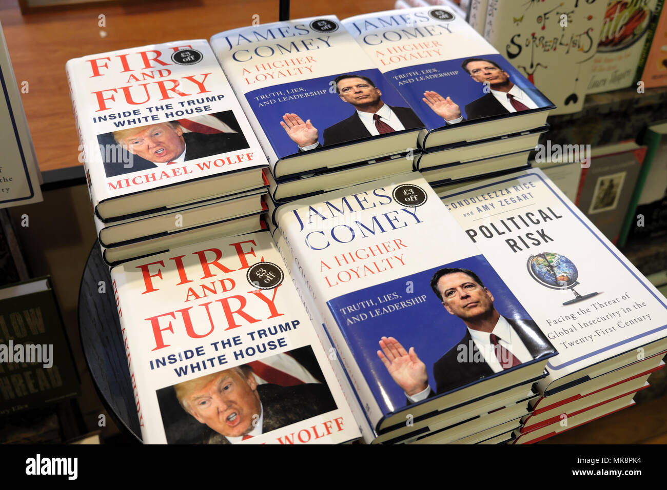 'Fire and Fury' Michael Wolfe book and 'A Higher Loyalty' James Comey books focussing on Donald Trump behaviour for sale in bookstore UK  KATHY DEWITT - Stock Image