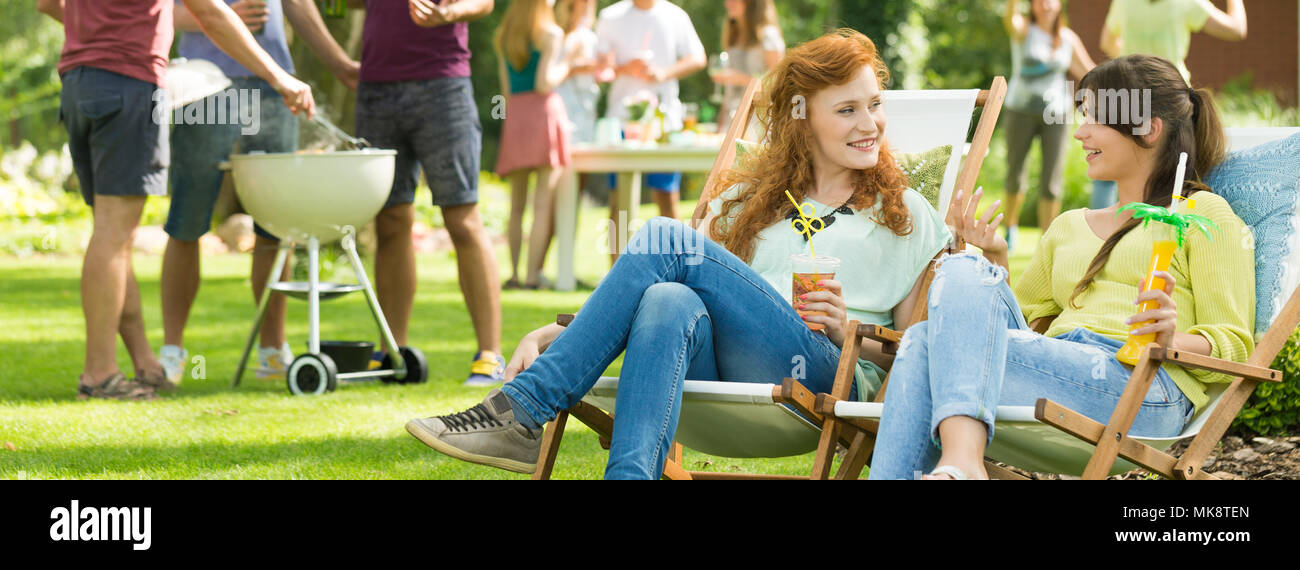 Girls having fun conversations during party in countryside Stock Photo
