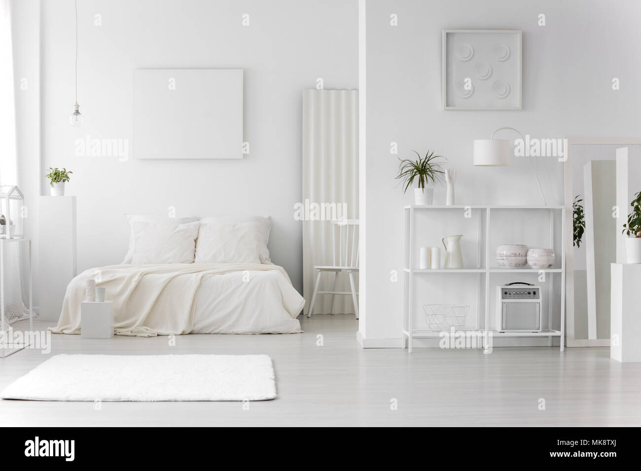Rug in minimal white bedroom interior with empty poster ...