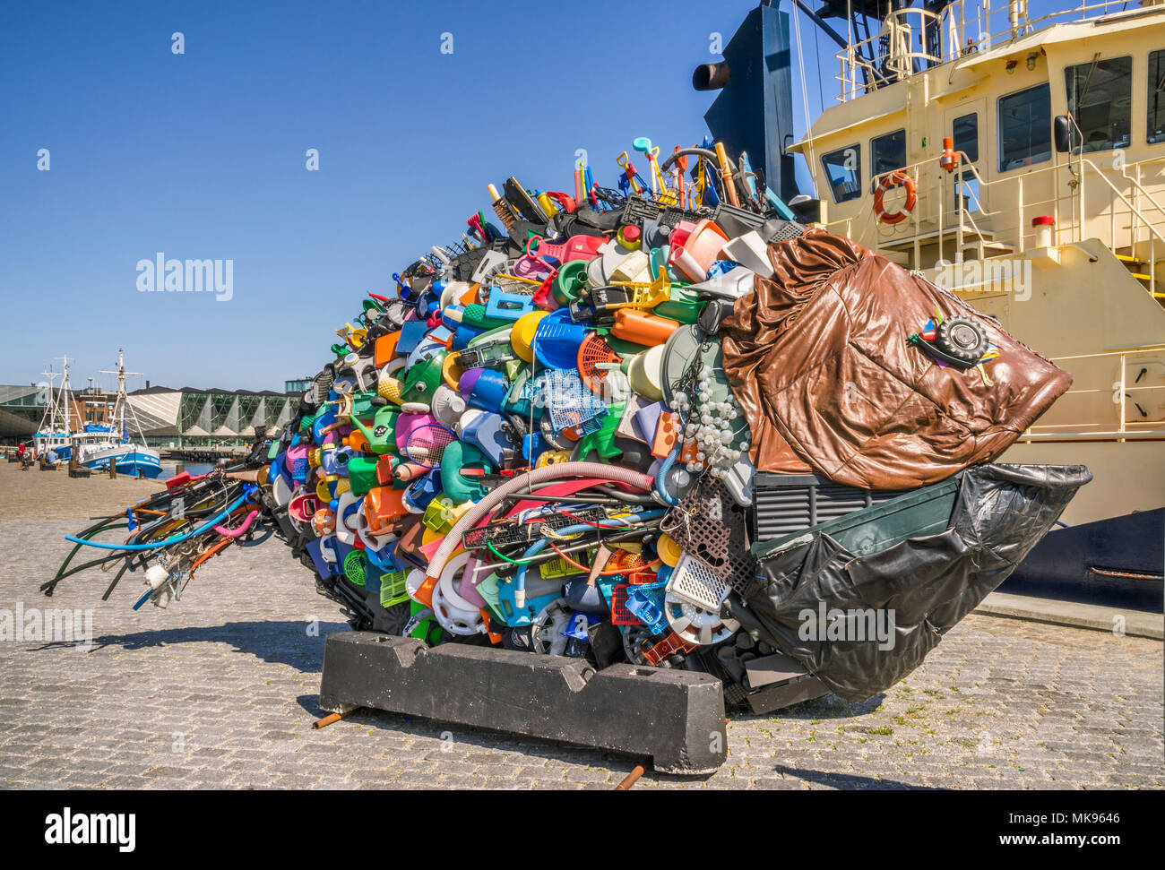 giant fish art installation titled 'Golden Bream from the Øre Sound' by the Japanese art unit Yodegawa Technique, made of discarted garbage items, Por - Stock Image