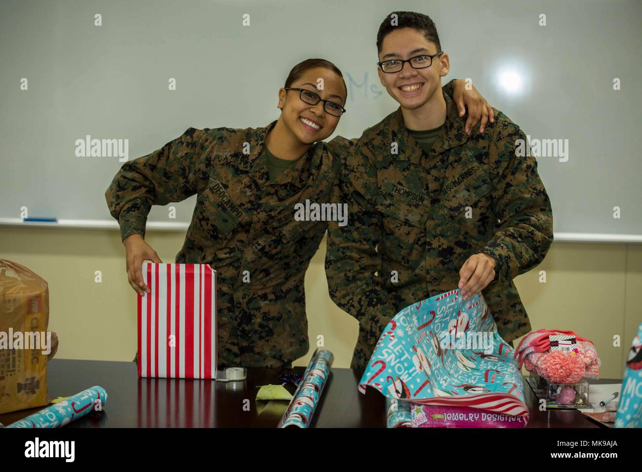 U.S. Marine Corps Lance Cpl. Cyndell Deocampo, left, an aviation ...
