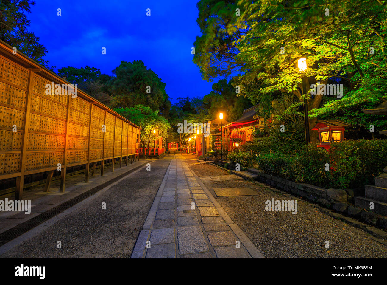 Kyoto, Japan - April 25, 2017: Illuminated path at dusk from Yasaka Shrine to the Gion weeping cherry tree in Maruyama Park. Gion Shrine is one of the most famous shrines in Kyoto, Japan . - Stock Image