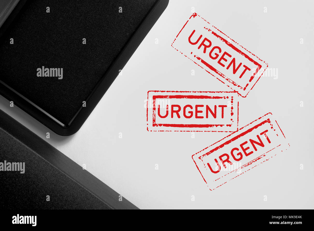 Multiple Urgent stamps on white background. - Stock Image