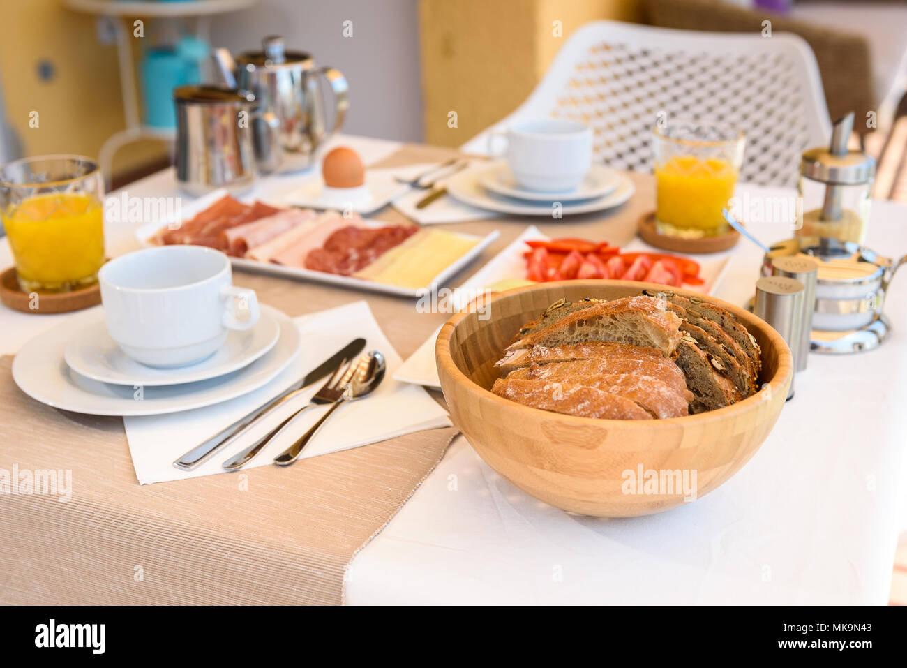 Continental morning breakfast table setting with sea view is served ...