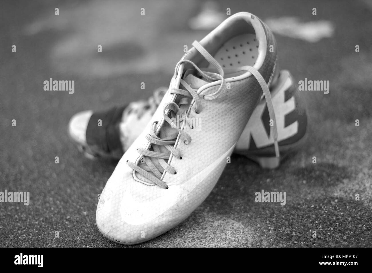 Yakima, Washington / USA - December 17, 2016:  Worn out and well loved soccer cleats displayed in an artistic photograph. - Stock Image
