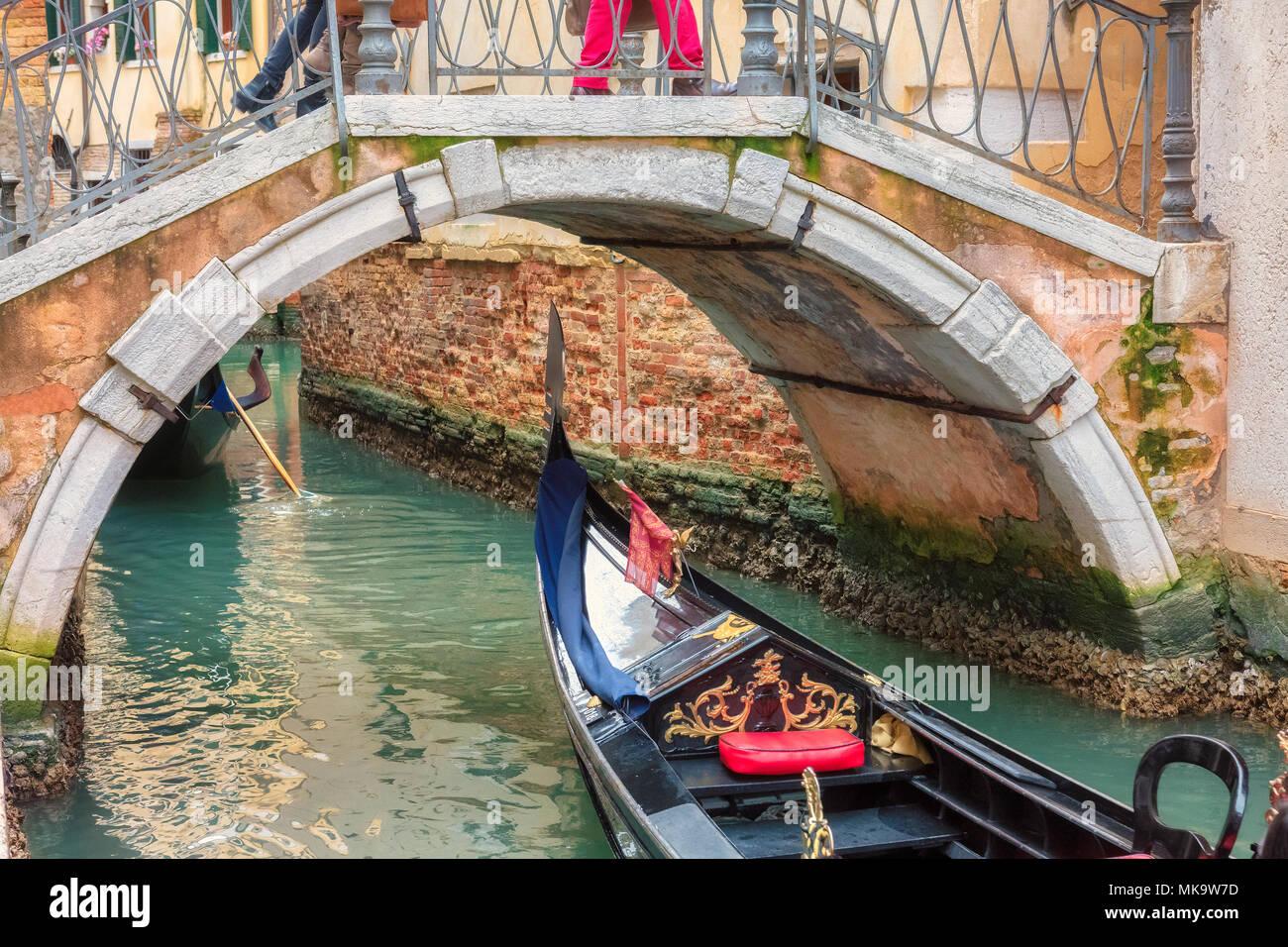 Venetian canal with gondola in Venice, Italy. - Stock Image