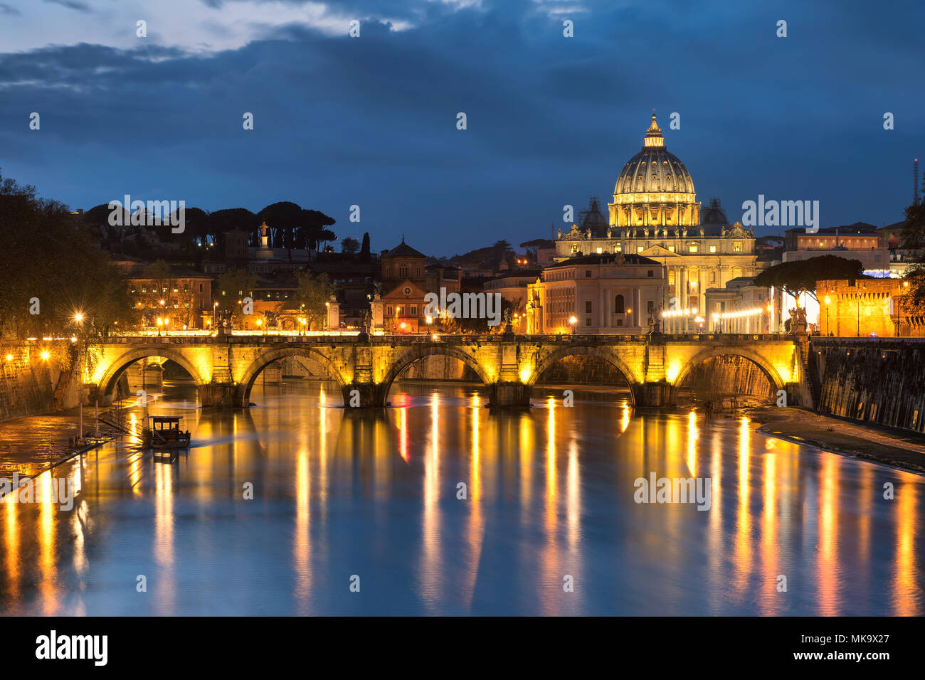 Night View at Tiber and St. Peter's cathedral in Rome, Italy. - Stock Image