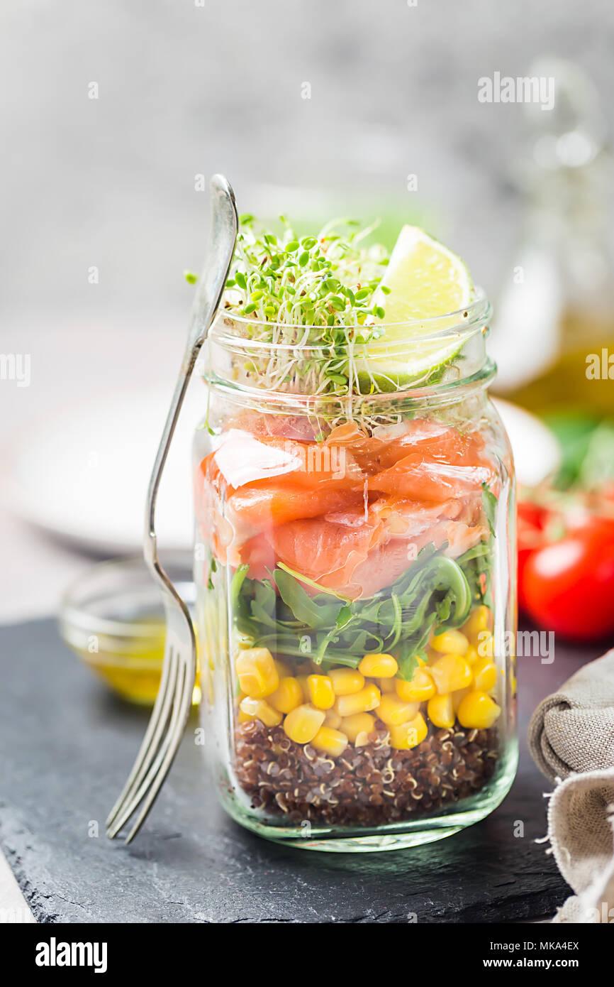 Fresh spring salad with salmon, quinoa, arugula, cress salad