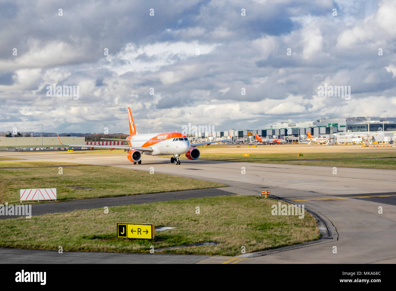 Easyjet air plane on the airfield at Gatwick airport (LGW) , Surrey, England, UK - Stock Image
