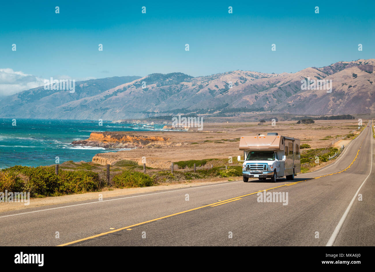 Panorama view of recreational vehicle driving on famous Highway 1 along the beautiful Central Coast of California, Big Sur, USA - Stock Image