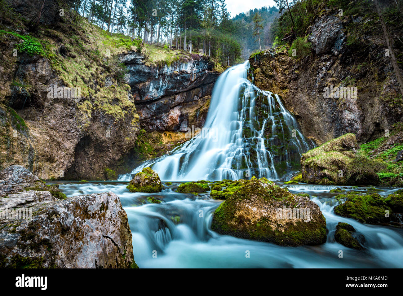 Beautiful view of famous Gollinger Wasserfall with mossy rocks and green trees on a moody in springtime, Golling, Salzburger Land, Austria Stock Photo